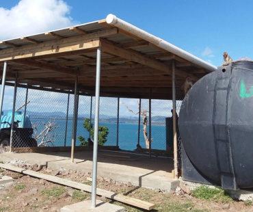 09_NPRC_Aug2018Team_IMG_2750-roof-rain-collection-pipe_lrg